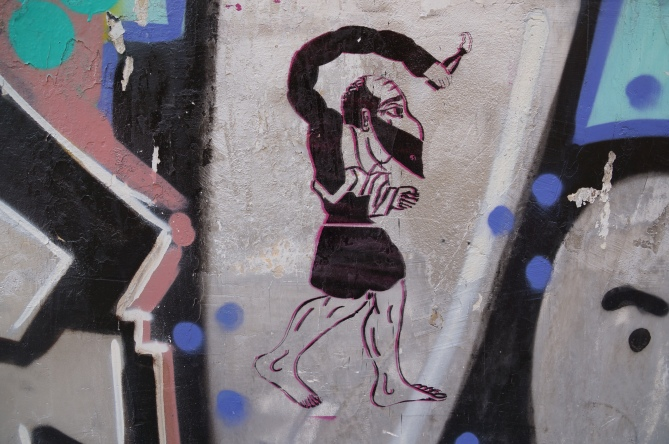 One of the graffiti images that Sotirios has photographed off the streets of Athens to include in his new book, Graffiti Over Marble - depicting the shadow puppet character of Karagiozis throwing a Molotov bomb.